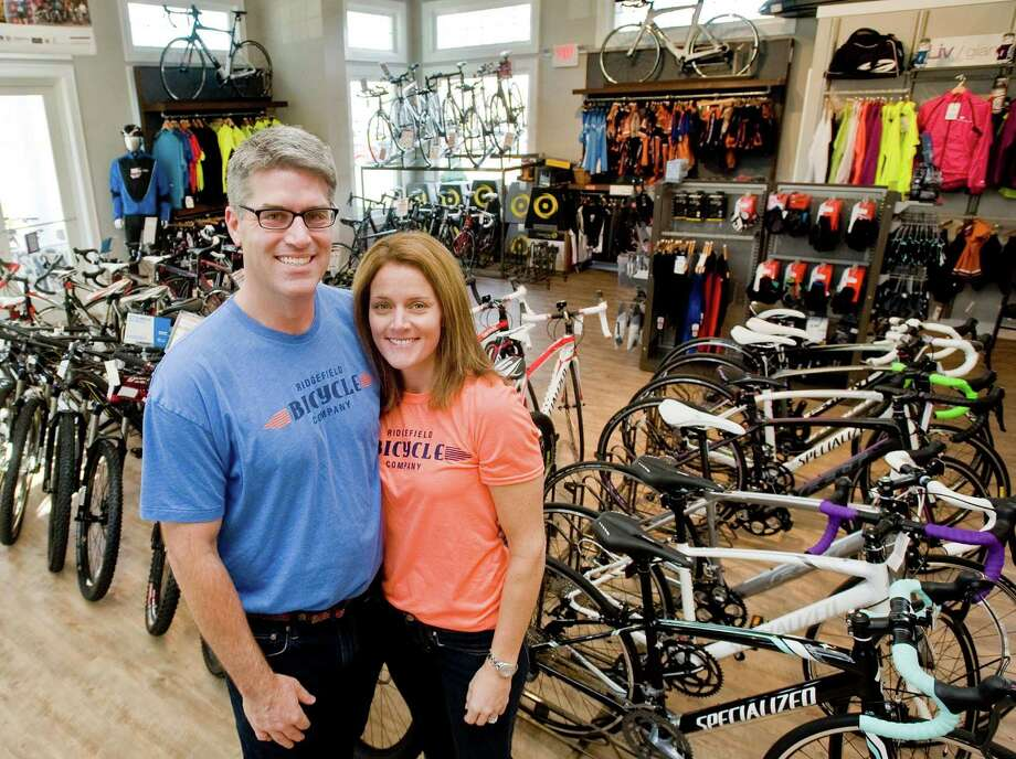 Ridgefield Bicycle Company co-owners Sean and Jacqui Dowd at their store on Danbury Road in Ridgefield. Wednesday, Nov. 20, 2013 Photo: Scott Mullin / The News-Times Freelance