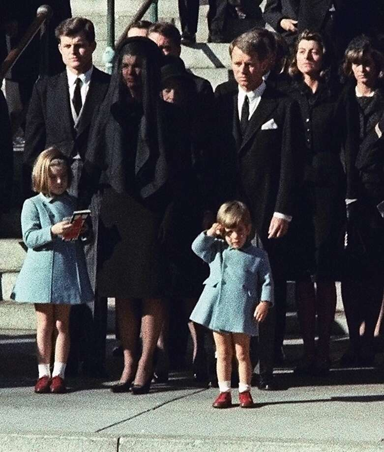 FILE - In this Monday, Nov. 25, 1963 file photo, 3-year-old John F. Kennedy Jr. salutes his father's casket in Washington, three days after the president was assassinated in Dallas. Widow Jacqueline Kennedy, center, and daughter Caroline Kennedy are accompanied by the late president's brothers Sen. Edward Kennedy, left, and Attorney General Robert Kennedy. (AP Photo/File) Photo: Associated Press