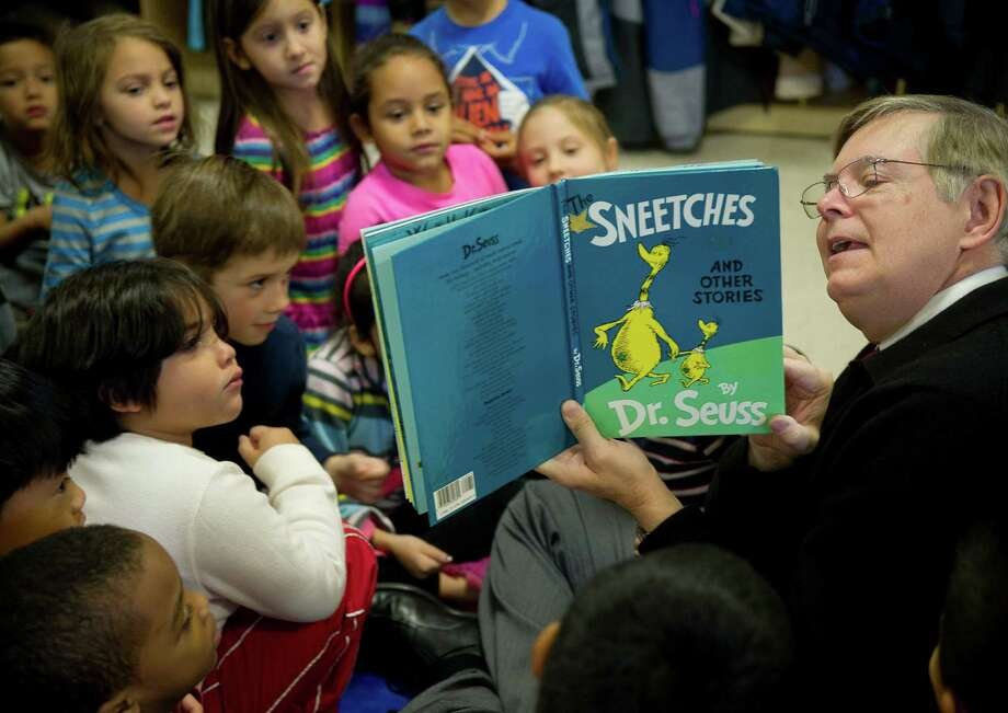 Stamford mayor-elect David Martin reads The Sneeches by Dr. Seuss to first-grade students at Springdale Elementary school on Wednesday, November 20, 2013. The visit fulfills a promise he madetp the students during a pre-election visit that if he won the election he would return to read to them. Photo: Lindsay Perry / Stamford Advocate