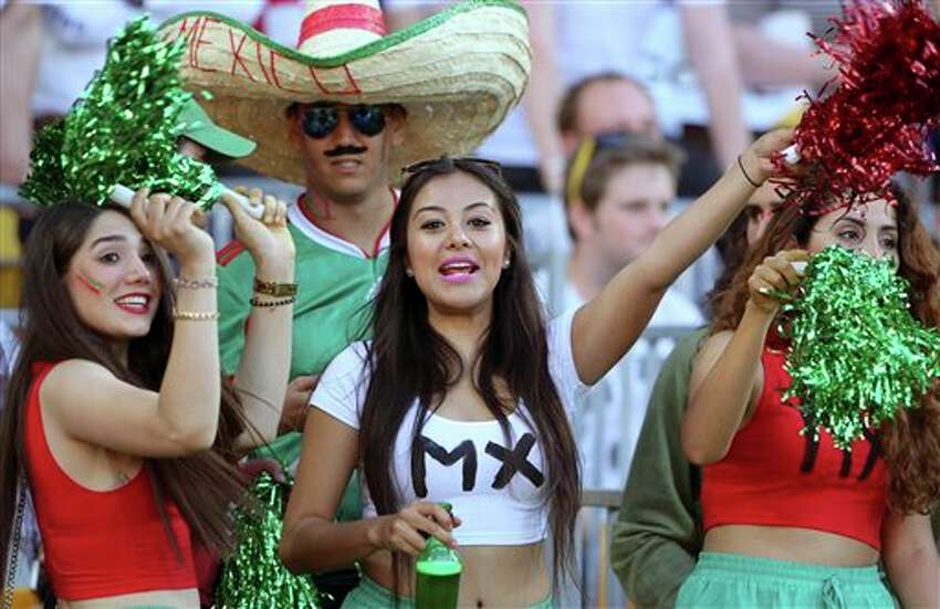 Mexican fans celebrate a goal in the World Cup soccer qualifier against New Zealand at Westpac Stadium in Wellington, New Zealand, Wednesday, Nov. 20, 2013. (AP Photo/SNPA, John Cowpland) NEW ZEALAND OUT