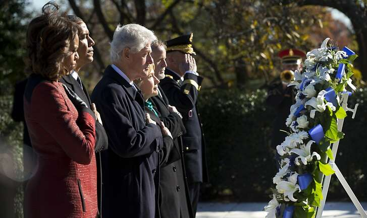 President Barack Obama, first lady Michelle Obama, former President Bill Clinton and his wife, former Secretary of State Hillary Rodham Clinton, pause during a wreath laying ceremony in honor of President John F. Kennedy, Wednesday, Nov. 20, 2013, at the JFK gravesite at Arlington National Cemetery in Arlington, Va. Friday will mark the 50th anniversary of the JFK assassination. (AP Photo/Pablo Martinez Monsivais)