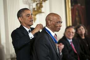 President Barack Obama presents the Presidential Medal of Freedom to baseball Hall of Famer Ernie Banks at a ceremony held at the White House on Nov. 20, 2013. The ceremony was part of commemorations of the 50th anniversary of the assassination of John F. Kennedy, who was killed just weeks before the first Medals of Freedom were to be awarded. (Gabriella Demczuk/The New York Times)