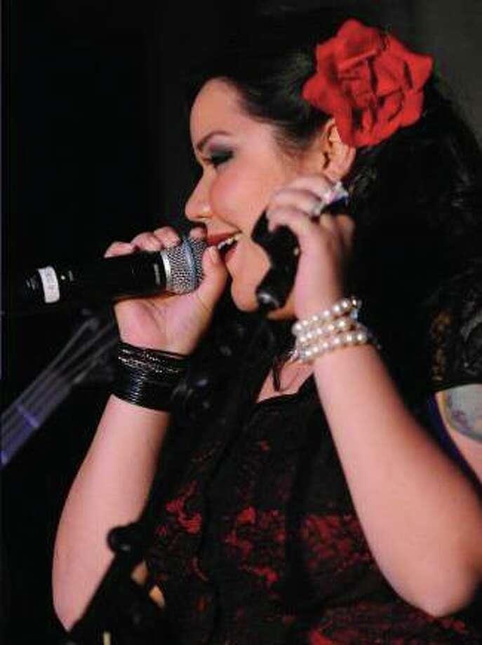 Josie Arias hosts karaoke weekly at F Bar. Photo: Courtesy Photo