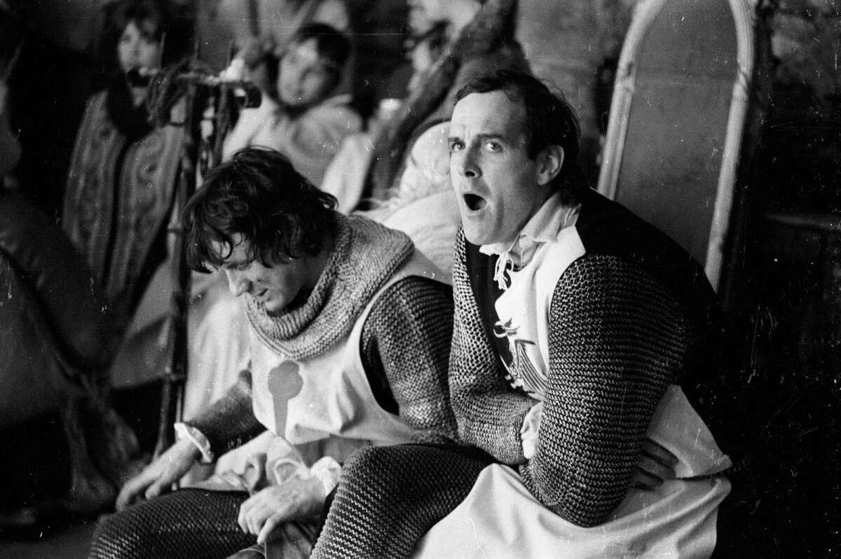 """""""We eat and drink and (you know what) a lot, in Camelot."""" Michael Palin (left) and John Cleese, dressed and ready for action on the set of 'Monty Python and the Holy Grail' on May 21, 1974."""