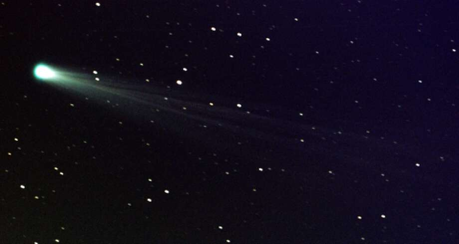 Comet ISON shows off its tail in this three-minute exposure taken on Nov. 19,. 2013 at 6:10 a.m. EST, using a 14-inch telescope located at the Marshall Space Flight Center. The comet is just nine days away from its close encounter with the sun; hopefully it will survive to put on a nice show during the first week of December. The star images are trailed because the telescope is tracking on the comet, which is now exhibiting obvious motion with respect to the background stars over a period of minutes. At the time of this image, Comet ISON was some 44 million miles from the sun -- and 80 million miles from Earth -- moving at a speed of 136,700 miles per hour. Credit: NASA/MSFC/Aaron Kingery