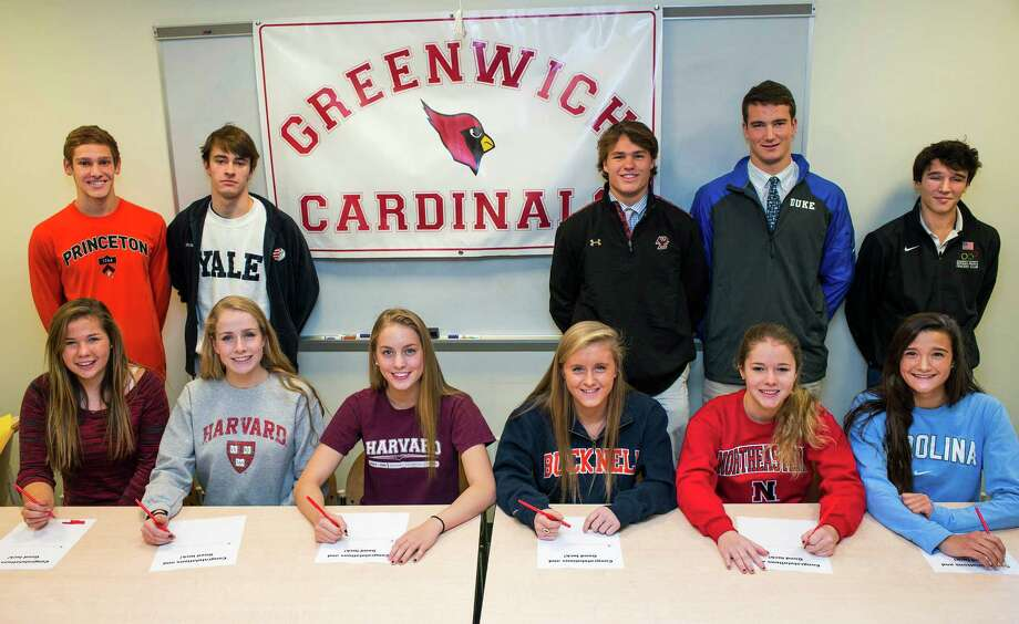 Eleven Greenwich high school athletes who have signed National letters of intent for colleges meet in the Media Center at Greenwich high school, Greenwich, CT on Wednesday, November, 20th, 2013. Left to right front row: Sarah Reswow (crew/George Washington University), Hollis Jomo (water polo/Harvard), Katie Evans (swimming/Harvard), Anna Black (track/Bucknell), Kim Hill (swimming/Northwestern University), Carolyn Paletta (lacrosse/University of North Carolina-Chapel Hill). Left to right back row: Alexander Lewis (swimming/Princeton), Thomas Kingshott (squash/Yale), Kyle Dunster (baseball/Boston College), Jack Harrington (lacrosse/Duke), Harry McGuire (fencing/University of Pennsylvania). Photo: Mark Conrad / Connecticut Post Freelance