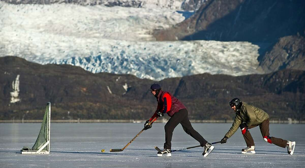 Piece of cake on the lake: With no goalie to stop him, Laurent Dick easily puts the biscuit in the basket during a pickup game on Juneau's Mendenhall Lake.