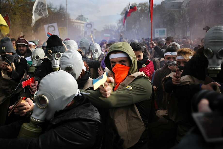 Wearing gas masks and brandishing cardboard weapons, students rally in Sofia against corrupt government and sweetheart deals for business. About 1,000 students demanded that Prime Minister Plamen Oresharski resign. Photo: Nikolay Doychinov, AFP/Getty Images