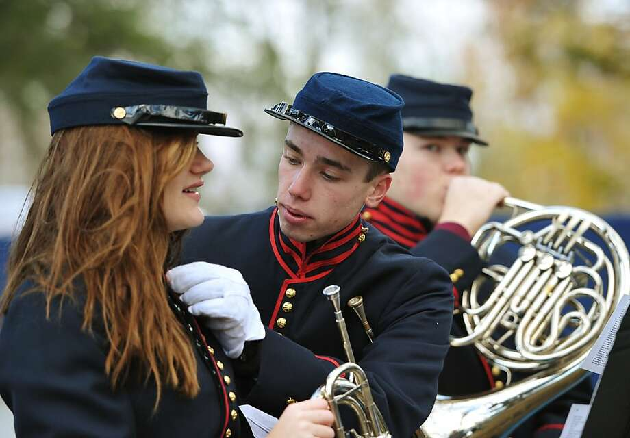 Band aid:A gentleman assists a fellow brass musician with her buttons before the commemoration ceremony for the 150th anniversary of the Gettysburg Address at Gettysburg National Military Park. Photo: Mandel Ngan, AFP/Getty Images