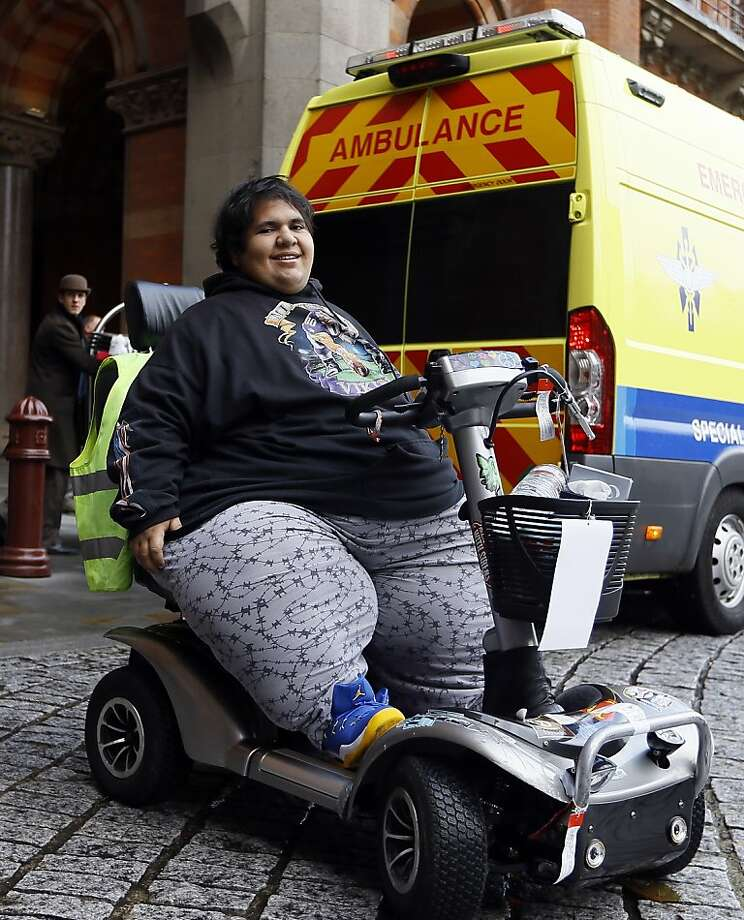 Deemed 'too fat to fly,'by British Airlines, Frenchman Kevin Chenais has now been refused travel on a train by   Eurostar, the service that connects England to France and Belgium, because of safety regulations. Eurostar did,   however, offer to compensate Chenais, who suffers from a medical condition, for his London stay. He now is   hoping to travel by ambulance and ferry back to France. Photo: Kirsty Wigglesworth, Associated Press