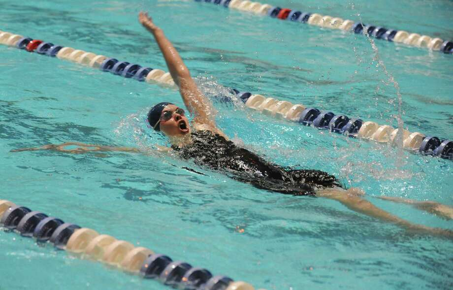 Staples' Amelia Bullock races in the 200 Yard Intermediate Medley Saturday, Nov. 16, 2013 at the CIAC Open Championship at Yale's Kiputh Pool in New Haven, Conn. Photo: Autumn Driscoll / Connecticut Post