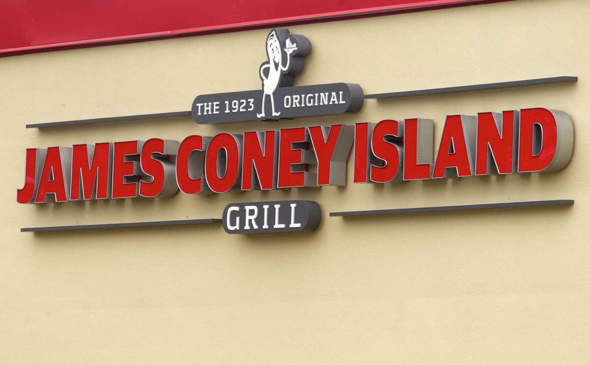 The new JCI Grill sign sits on top of the James Coney Island off of Hollister on Wednesday, Nov. 20, 2013, in Houston. The company is gradually changing its name and rebranding itself for a more modern day experience. It will also be expanding its menu.