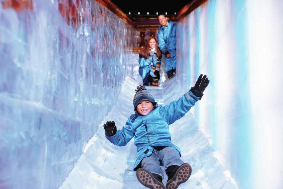 "The ice slide is part of the Gaylord Texan's ""ICE!"" attraction, with over 2 million pounds of carved ice. / ONLINE_YES"