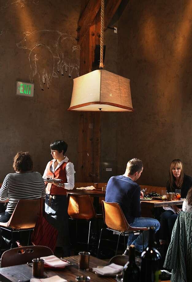 Alli Diaz serves lunch at Coqueta in San Francisco, California, on Thursday, November 14, 2013. Photo: Liz Hafalia, The Chronicle