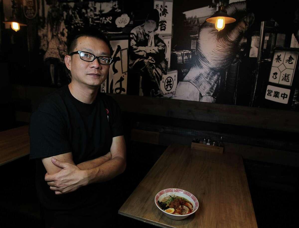 Tiger Den restaurant owner Mike Tran with a bowl of Tantan-Men Friday, Nov. 15, 2013, in Houston. ( James Nielsen / Houston Chronicle )