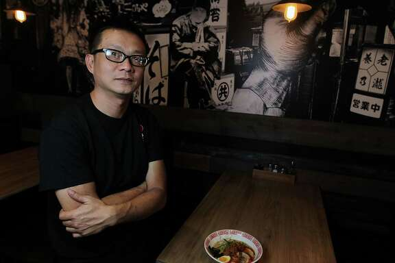 Tiger Den restaurant owner Mike Tran with a bowl of Tantan-Men Friday, Nov. 15, 2013, in Houston.  ( James Nielsen / Houston Chronicle )