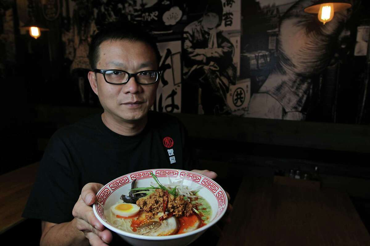 Mike Tran, the co-owner of new Chinatown restaurant Tiger Den, dishes out four varieties of ramen, including tantan ramen with pork.