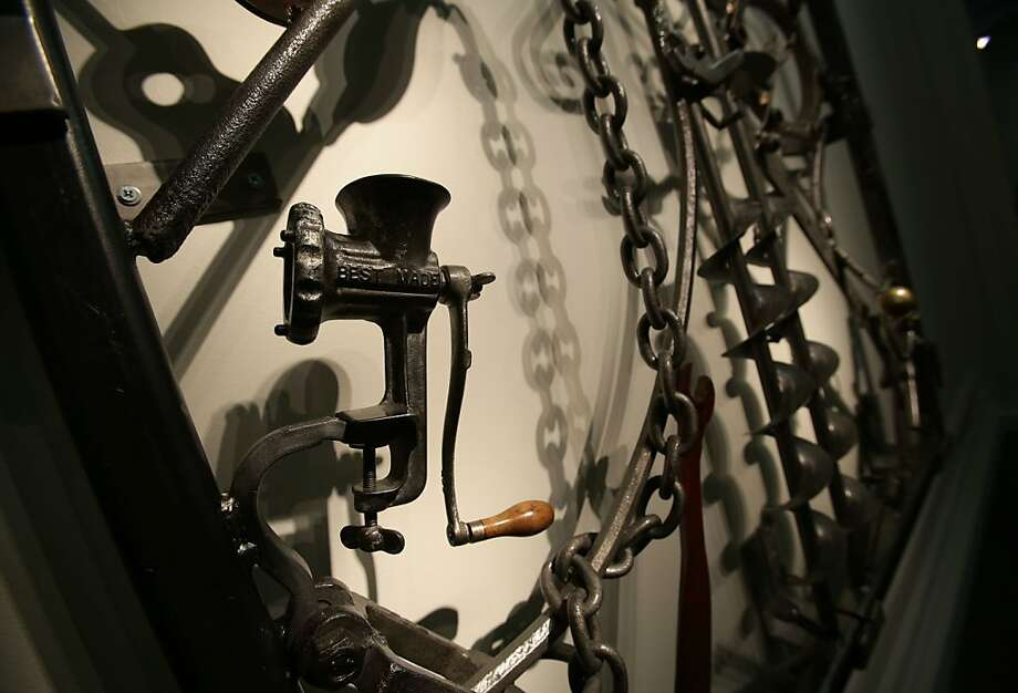 A vintage grinder finds new life in an iron gate. Photo: Yui Mok, Associated Press