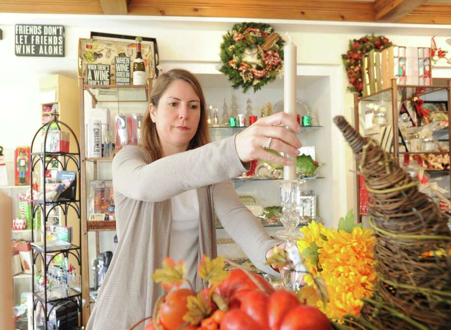 Sonia Sotire Malloy, owner of the Splurge store, sets-up a Thanksgiving display inside the store at 39 Lewis Street, Greenwich, Wednesday, Nov. 20, 2013. Photo: Bob Luckey / Greenwich Time