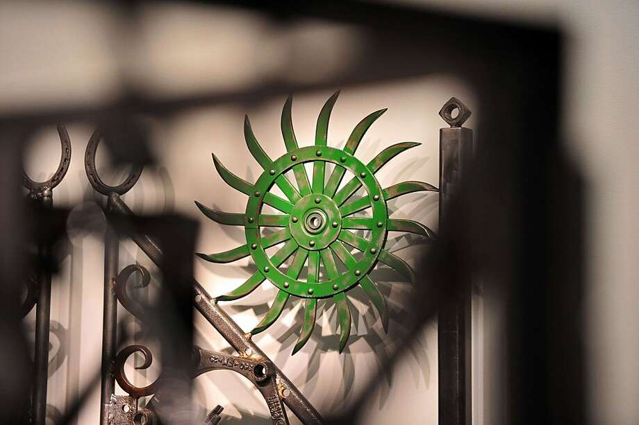"A sun-like cog adds color to ""Untitled II."" Photo: Carl Court, AFP/Getty Images"