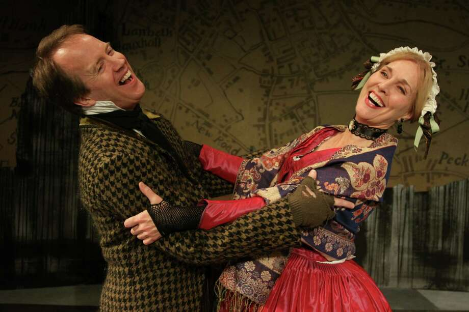 A happy couple (played by Doug Trapp and Marcy McGuigan) dance happily at the Fezziwig party in A Christmas Carol at Capital Repertory Theatre, Nov. 22 - Dec. 22, 2013, 111 N. Pearl St., Albany. (Richard Lovrich)