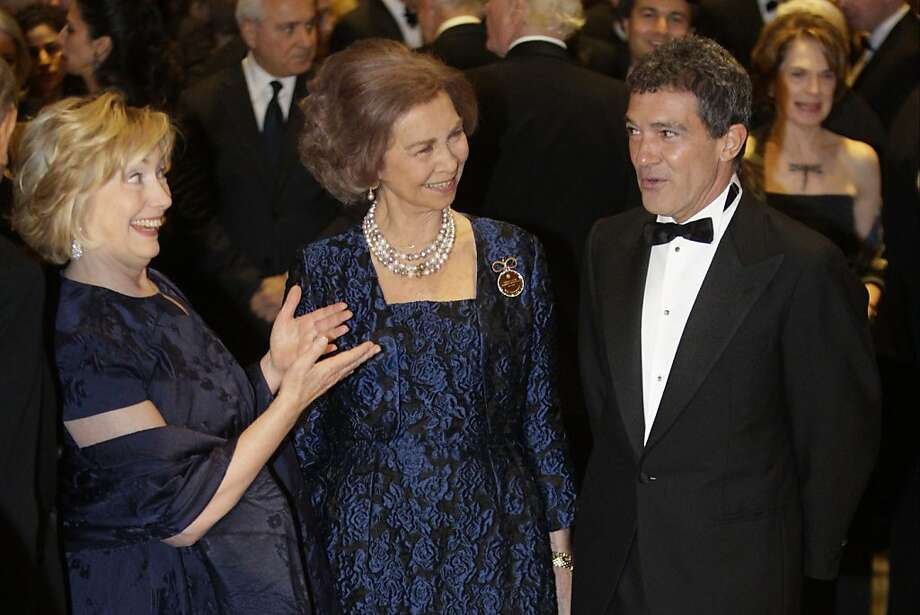 The guests of honor: Antonio Banderas charms Hillary Rodham Clinton - or maybe it's the other way around - at the Waldorf Astoria Hotel in New York. Queen Sofia of Spain (center) honored the pair with gold medals from her Spanish Institute for their contributions in building ties between the United States and Spanish-speaking countries. Photo: Frank Franklin II, Associated Press