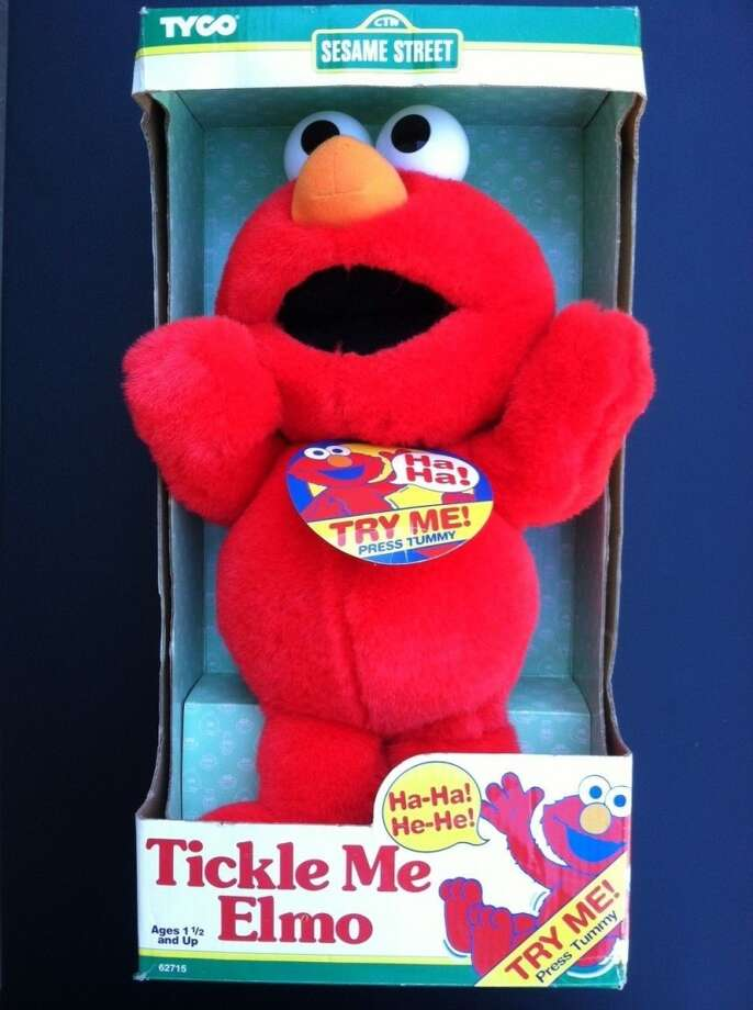 1996: Tickle Me Elmo.  The one that started it all.  You had to fight crowds to get him.  Source: http://voices.yahoo.com/the-10-year-history-elmo-138920.html?cat=46 Photo: Http://www.ebay.com