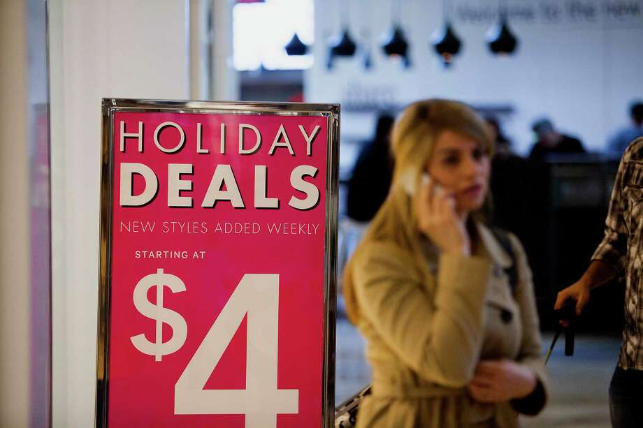 """It's December, the malls are bustling and """"Sale"""" signs are everywhere. Good time to grab the deals, right? Not so fast, says AP Retail Writer Mae Anderson.  Savvy shoppers should realize that some items are actually a better deal after the holiday season. As long as it's not something that has to be under the tree on Dec. 25, here's a look at purchases best made in the new year. Photo: Sam Hodgson, Bloomberg / � 2013 Bloomberg Finance LP"""