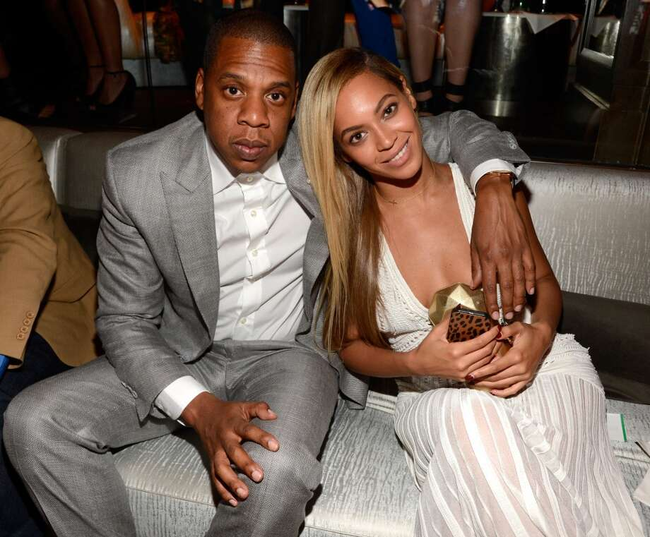 "Jay-Z and Beyonce shared the small screen for the first time in 2003 with the collaboration ""Crazy in Love."" No curse here: Mr. and Mrs. Z remain one of entertainment's most powerful couples. Photo: Kevin Mazur, WireImage"