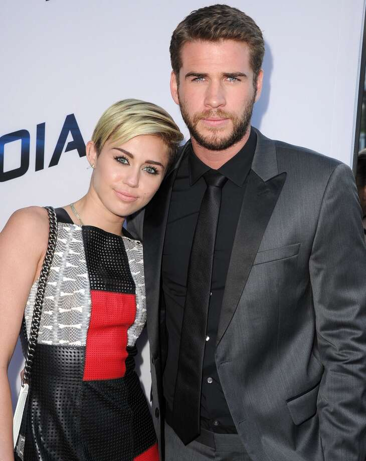 "Miley Cyrus and then-fiance Liam Hemsworth shared the screen in 2012's ""Decisions,"" featuring Miley making out with a unicorn headed Liam. The pair split in fall 2013 Photo: Steve Granitz, WireImage"