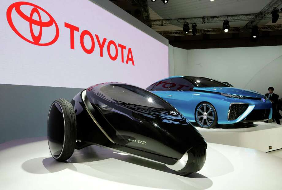 Toyota's FV2, left, and FCV concept cars are displayed at the media preview for the Tokyo Motor Show at the Tokyo Big Sight convention hall in Tokyo, Wednesday, Nov. 20, 2013. The biannual exhibition of vehicles in Japan runs for the public from Saturday, Nov. 23 through Dec. 1. (AP Photo/Shizuo Kambayashi) ORG XMIT: XKAN108 Photo: Shizuo Kambayashi / AP