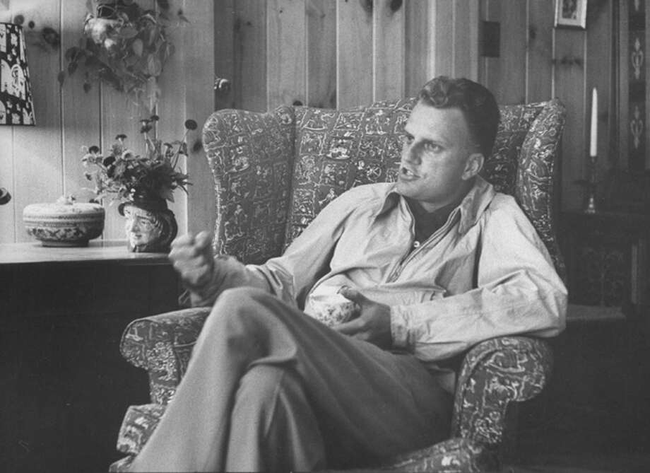 Here's a look at the early ministry and rise of Rev. Billy Graham.Evangelist, Billy Graham, sitting in easy chair, talking, in his home.  (Photo by Ed Clark//Time Life Pictures/Getty Images) Photo: Ed Clark, Time & Life Pictures/Getty Image / Time Life Pictures