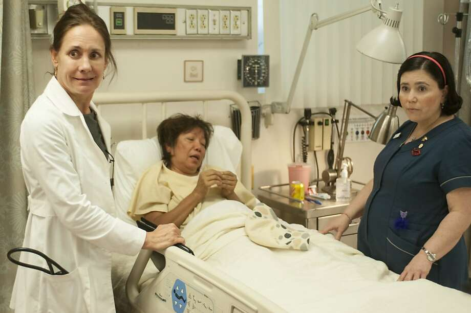 Laurie Metcalf (left) as Dr. Jenna James attends to patient Jalida Chung with the help of Alex Borstein as a nurse. Photo: Dale Robinette, HBO