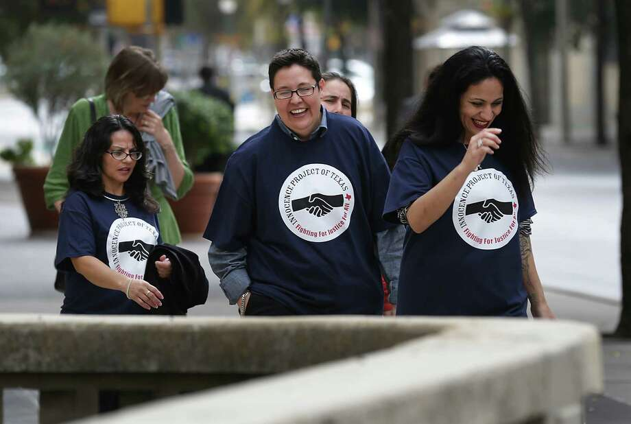 Elizabeth Ramirez, Kristie Mayhugh, Anna Vasquez, and Cassandra Rivera, walk to lunch in downtown San Antonio after the women known as the SA 4 held a press conference with their lawyers in the Tower Life Building. Wednesday, Nov. 20, 2013. Photo: BOB OWEN, San Antonio Express-News / © 2012 San Antonio Express-News