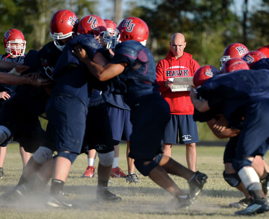 Coach Dwayne Dubois watches the offense run a play during practice at Hardin-Jefferson High School on Wednesday afternoon.  Photo taken Jake Daniels/@JakeD_in_SETX Photo: Jake Daniels / ©2013 The Beaumont Enterprise/Jake Daniels