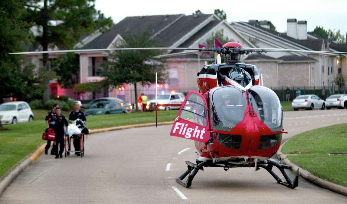 A shooting victim is taken to a LifeFlight helicopter after the aftermath of the shooting Wednesday.
