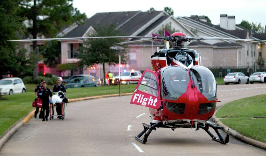 A shooting victim is taken to a LifeFlight helicopter after the aftermath of the shooting Wednesday. Photo: Brett Coomer, Houston Chronicle / © 2013 Houston Chronicle
