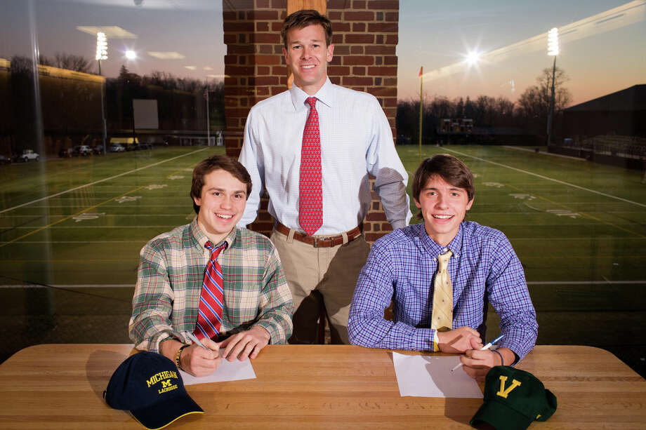 Brunswick School seniors Thomas Heidt (left) and Cameron Stafford (right) signed National Letters of Intent on Wednesday, November 20, 2013. Heidt will play lacrosse for Michigan and Stafford for Vermont. Standing behind them is varsity lacrosse coach David Bruce. Photo: Contributed Photo / Stamford Advocate Contributed