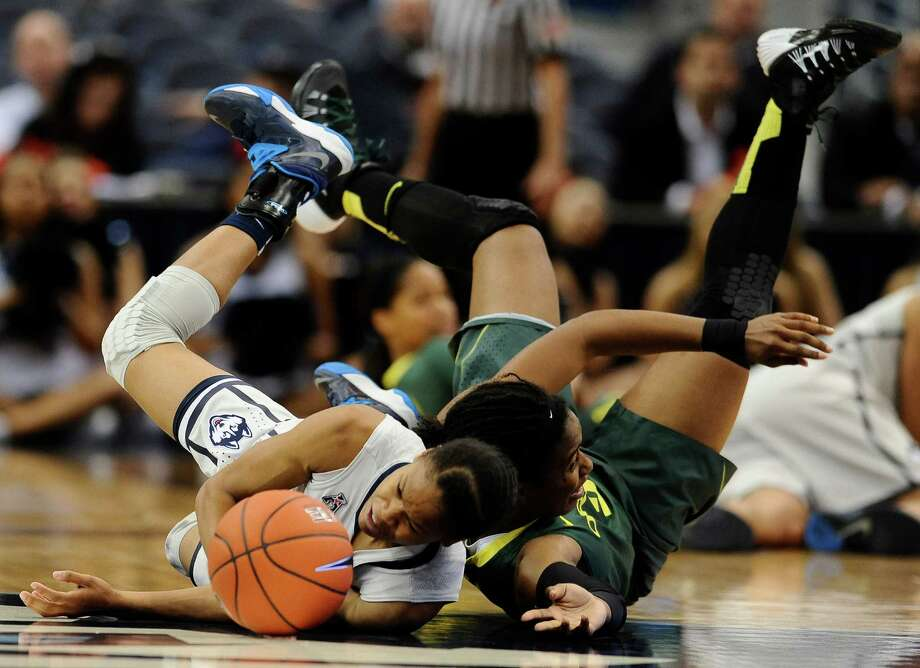 Connecticut's Moriah Jefferson, left, and Oregon's Chrishae Rowe, right, chase a loose ball during the first half of an NCAA college basketball game, Wednesday, Nov. 20, 2013, in Hartford, Conn. (AP Photo/Jessica Hill) Photo: Jessica Hill, Associated Press / Associated Press