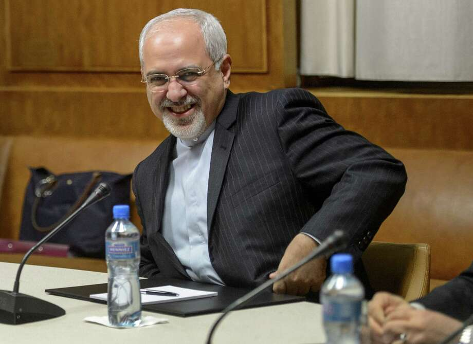 Iranian Foreign Minister Mohammad Javad Zarif and senior officials from six world powers met to discuss Iran's nuclear program amid opposition. Photo: FABRICE COFFRINI, Staff / AFP