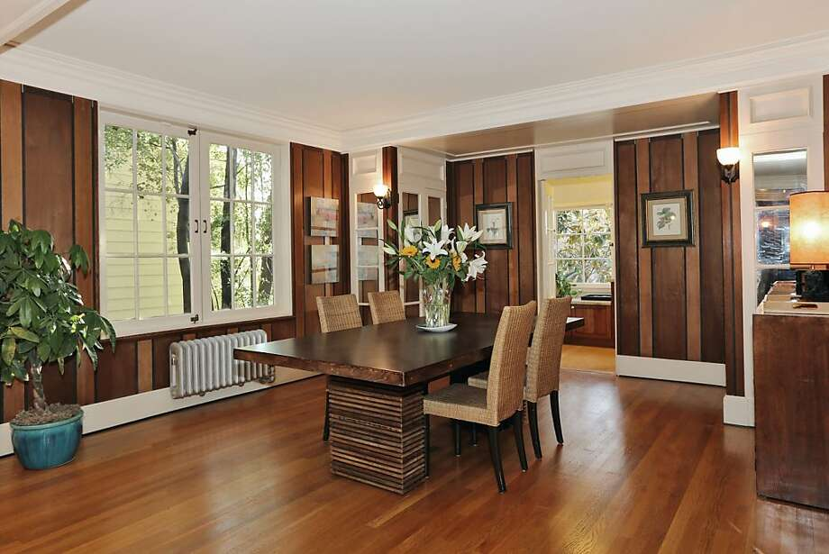 The formal dining room is decorated by wide moldings and wood-paneled walls. Photo: Liz Rusby/The Grubb Co.