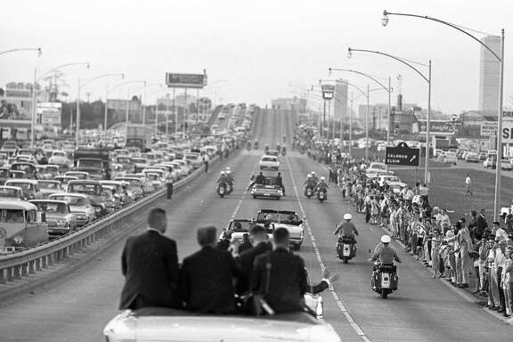 Presidential motorcade travels up the Gulf Freeway toward downtown, Nov. 21, 1963.
