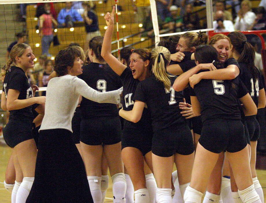 Coach Kirby Jameson (left) and the Clark Cougars revel in their Class 5A state championship victory over Allen in 2003. Photo: Express-News File Photo