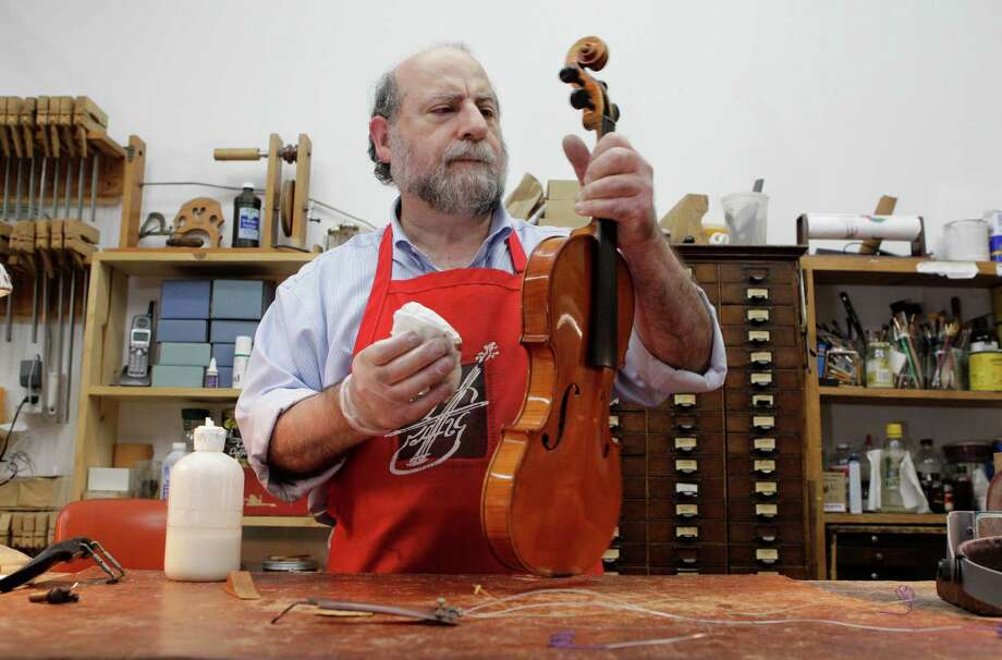 Philip Gold, who repairs instruments and makes bows in his Gold Violin Shop in Bellaire, played the violin in his youth, and later studied how to make them. Photo: Melissa Phillip, Staff / © 2013  Houston Chronicle
