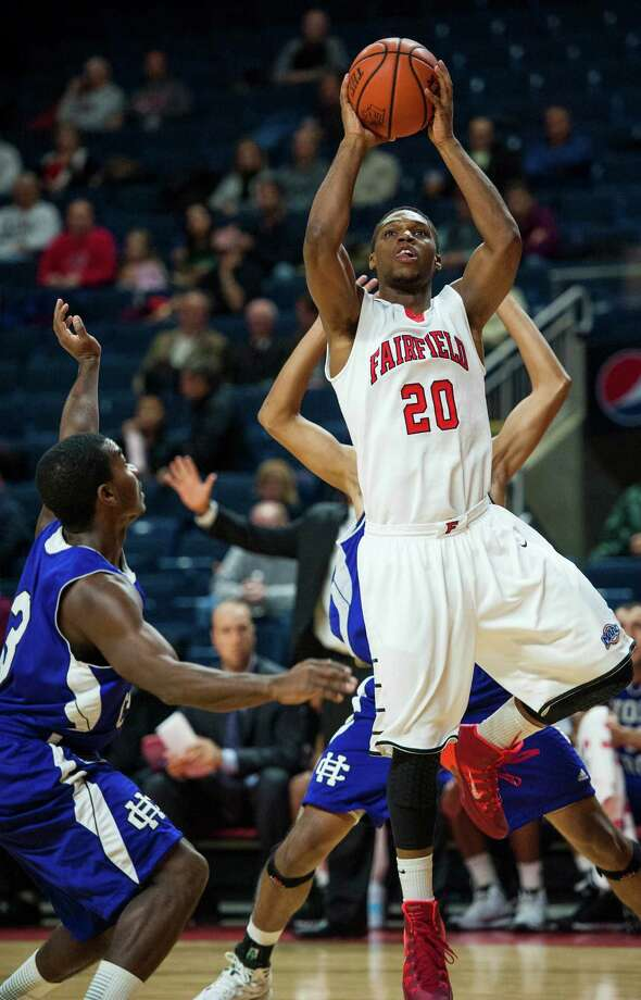 Fairfield University's K.J. Rose goes up for a shot during a men's basketball game against College of Holy Cross played at the Webster Bank Arena, Bridgeport, CT on Wednesday, November, 20th, 2013. Photo: Mark Conrad / Connecticut Post Freelance