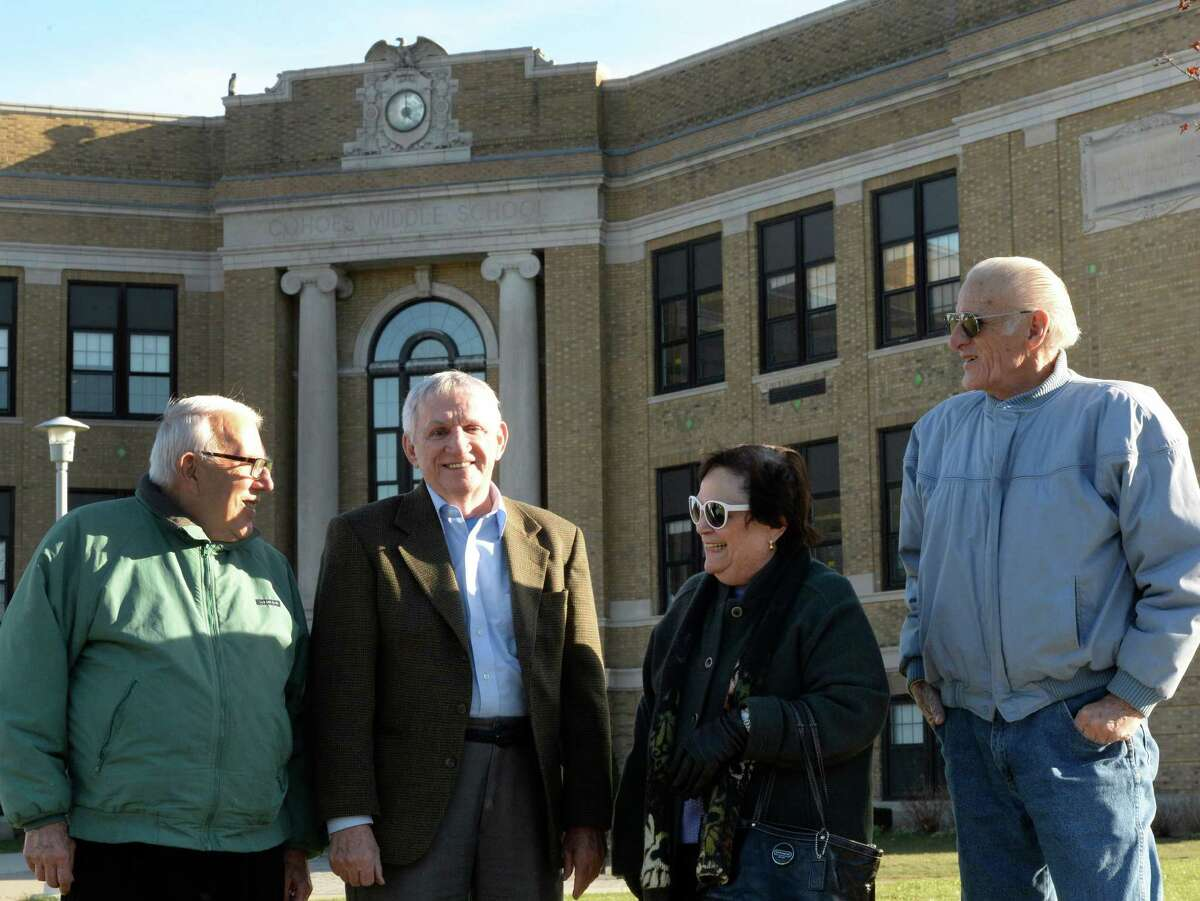 From left, John Grego, Chuck Malley, Barbara McDonald and Bill Reu stand beneath a clock that has been broken for decades. The four are members of the Cohoes High School Alumni Assocation. (Skip Dickstein/Times Union)