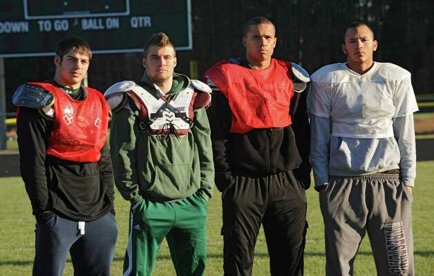 Schalmont linebackers, from left, Nick Gallo, Jack Batchler, Devon Willis and Trevon Perez-Tucker at practice on Wednesday, Nov. 20, 2013 in Albany, N.Y. (Lori Van Buren / Times Union) Photo: Lori Van Buren / 00024737A
