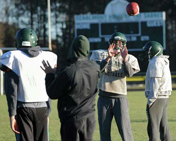 Schalmont lineman Aaron Smith, second from right, tosses a ball with a teammate at football practice on Wednesday, Nov. 20, 2013 in Albany, N.Y. (Lori Van Buren / Times Union) Photo: Lori Van Buren / 00024737A