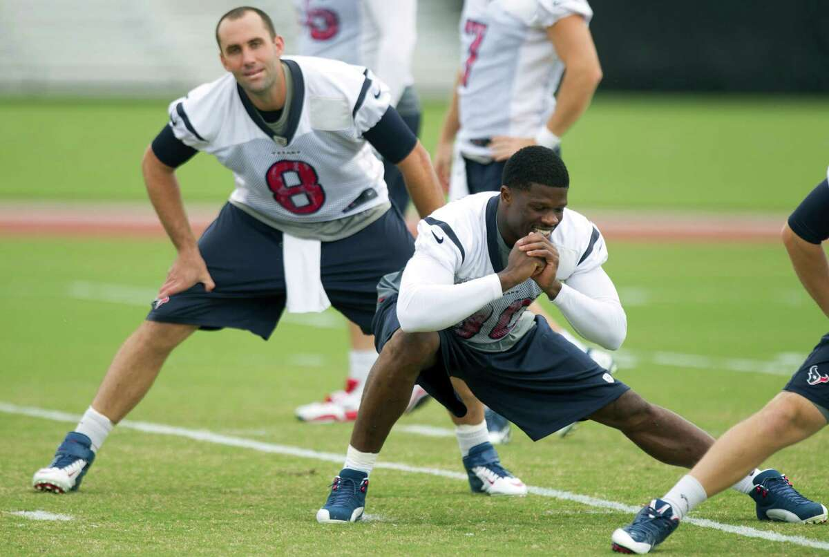 Bygones appear to be bygones as Matt Schaub, left, and Andre Johnson, who engaged in a verbal confrontation Sunday, stretch before Wednesday's practice.