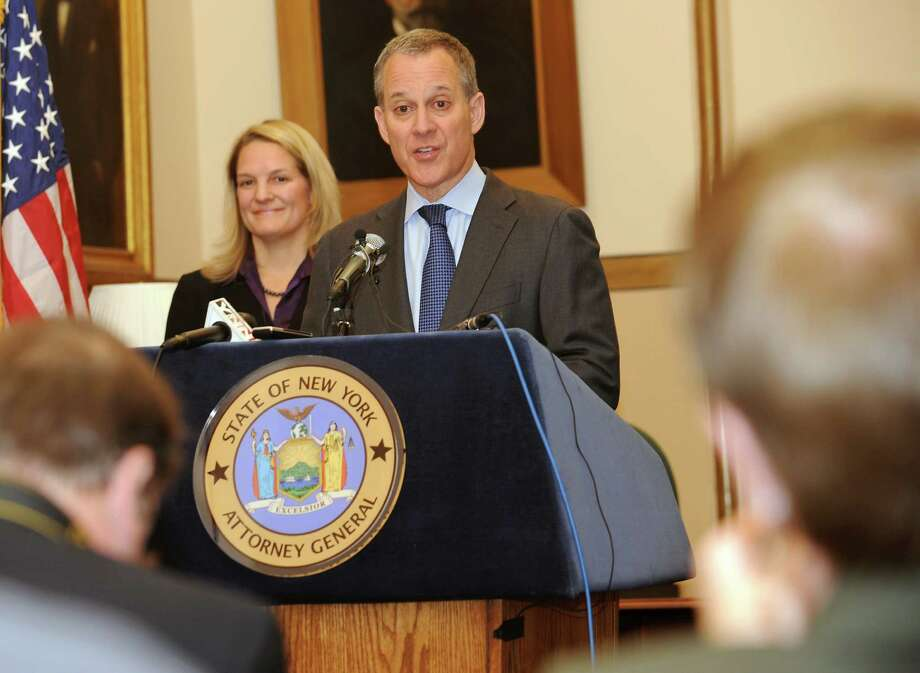 Attorney General Eric Schneiderman discusses the 13 billion dollar settlement with JP Morgan on Wednesday, Nov. 20, 2013 in Albany, N.Y. Kirsten Keefe of the Empire Justice Center listens at left. (Lori Van Buren / Times Union) Photo: Lori Van Buren / 00024730A